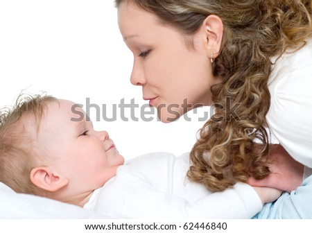 Beautiful young mum and her daughter - stock photo