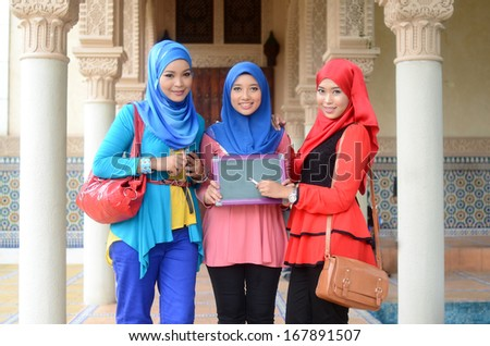 beautiful young muslim student smile with green board - stock photo