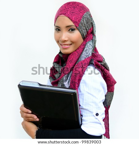 Beautiful young muslim woman smile with laptop isolated white background - stock photo