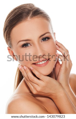Beautiful young natural caucasian woman over white background - stock photo