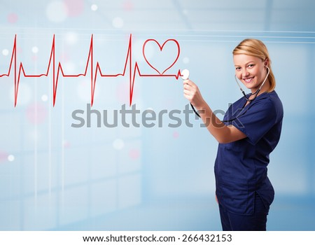 Beautiful young nurse listening to abstract pulse with red heart - stock photo