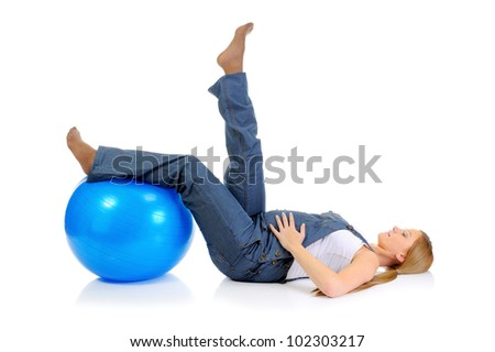 Beautiful young pregnant woman does sport exercises with a blue ball. Isolated on white background - stock photo