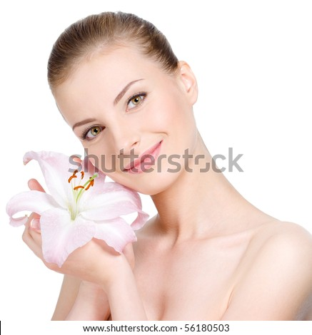 Beautiful young pretty smiling woman holding flower near the face - isolated - stock photo