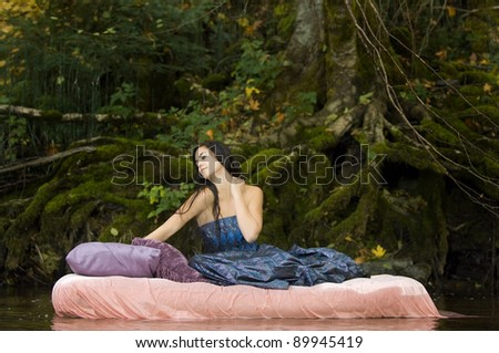 Beautiful Young Princess Awakens in Woodland Stream - stock photo