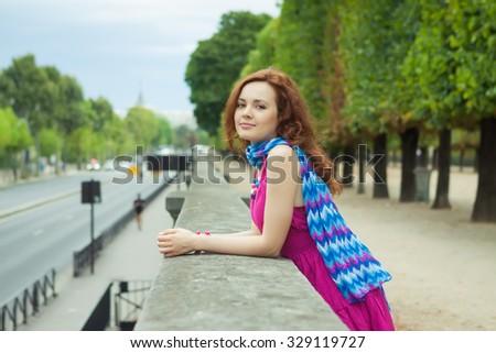 Beautiful young redhead woman in Paris  - stock photo