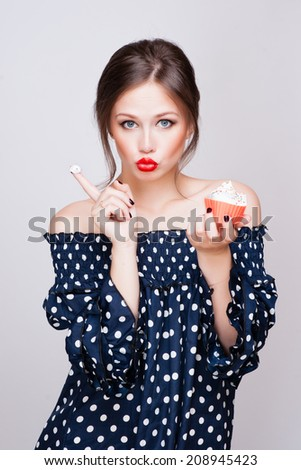 beautiful young retro pinup woman eat sweet cake food isolated on white in studio - stock photo