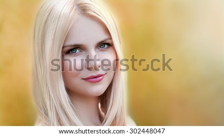 Beautiful young romantic elegant woman face, has blue eyes, blonde nature hair. Autumn background. Pure makeup. Nature dye - stock photo