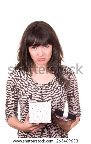 beautiful young sad girl holding present wrapped in a box isolated on white - stock photo