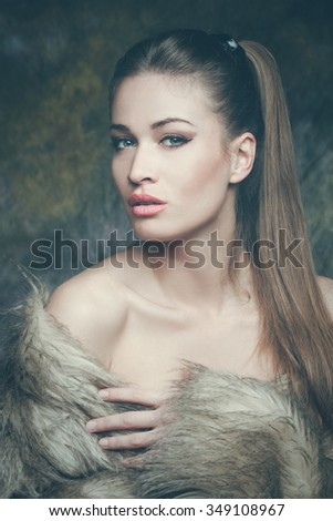 beautiful young sensual woman with artificial fur  portrait, studio shot, front view - stock photo
