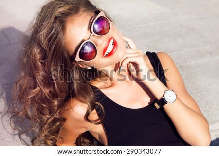Beautiful young sexy brunette girl in a dress and makeup, summer trip on a yacht with white sails on the sea or ocean in the Gulf marine of the wind and the breeze in the sun tans romantic,hairstyle - stock photo