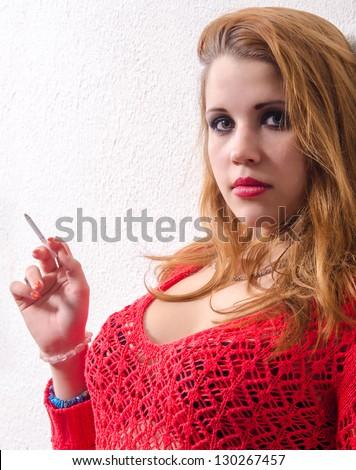 Beautiful young sexy girl smoking cigarette. - stock photo