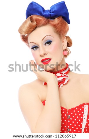 Beautiful young sexy pin-up girl in polka dot corset on white background - stock photo