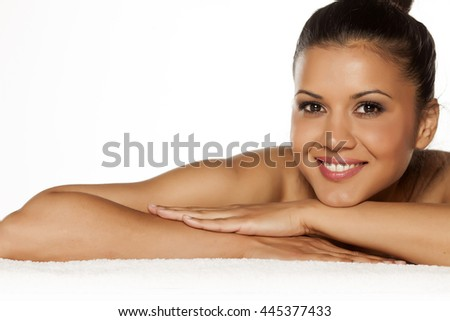 beautiful young smiling latina lying on the towel - stock photo