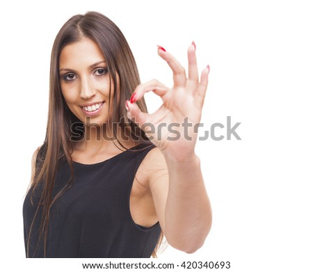 Beautiful young smiling woman showing Ok sign, isolated on white background - stock photo