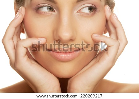 Beautiful young smiling woman with healthy skin - stock photo