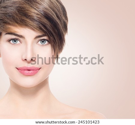 Beautiful young spa woman with short hair portrait. Attractive girl Face with perfect Clean Fresh Skin close up. Beauty model. Blue eyed Lady Smiling. Youth and Skin Care Concept  - stock photo
