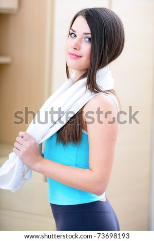 Beautiful young sport woman with towel - stock photo