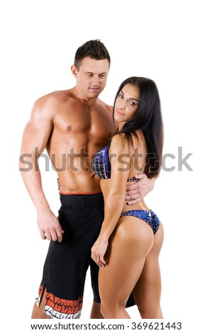 beautiful young sports men and women bodybuilding and fitness. Girl and boy. isolated on white background - stock photo