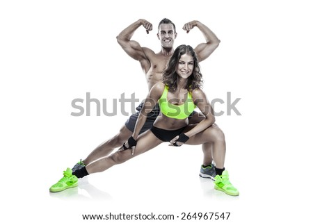 beautiful young sporty couple posing and showing muscle isolated over white background - stock photo