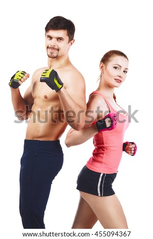 Beautiful young sporty sexy couple showing muscle  isolated on white - stock photo
