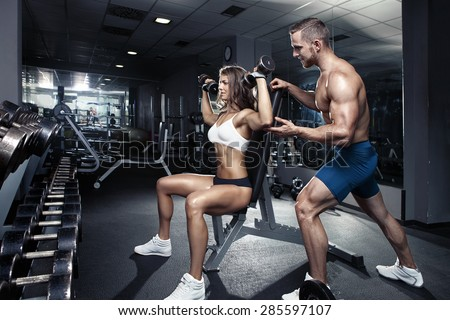 beautiful young sporty sexy couple workout in gym - stock photo