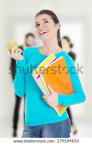 Beautiful young student with files and apple. - stock photo