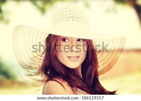 Beautiful young summer woman in hat - stock photo