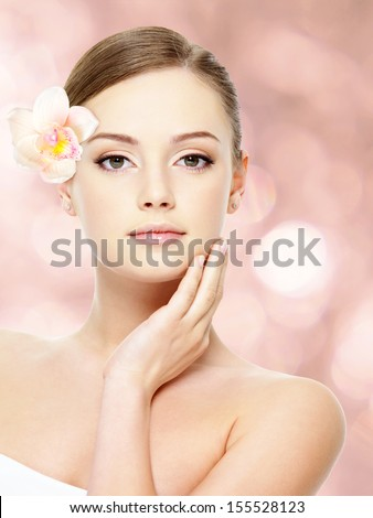 Beautiful young teen with healthy clean skin of the face - isolated on white - stock photo
