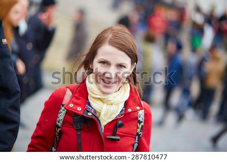 Beautiful young tourist in Paris, taking a photo on the street - stock photo