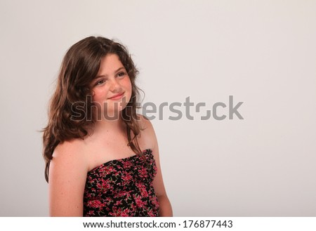 Beautiful young tubby brunette girl in studio - stock photo