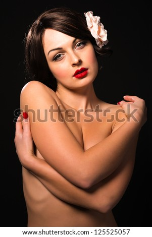 Beautiful young Ukrainian woman nude on black - stock photo