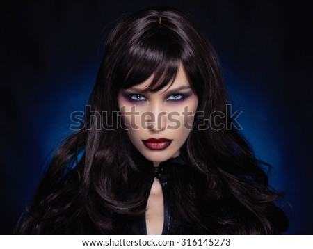 beautiful young vampire woman.black haired sexy halloween girl - stock photo