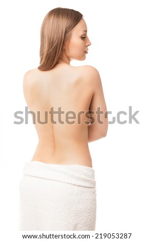 Beautiful young woman after bath with towel isolated on white background - stock photo