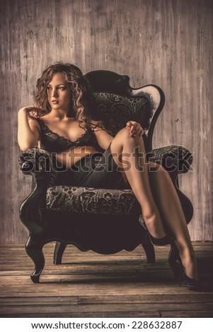Beautiful young woman alluring in sexual lingerie. Beauty, fashion. Vintage style. - stock photo