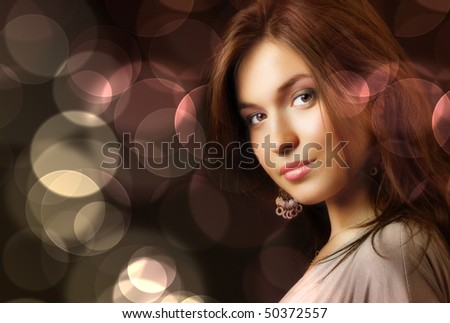 Beautiful young woman and glamour city night lights - stock photo