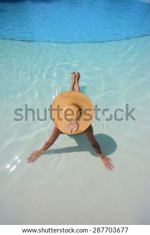 Beautiful young woman at a pool in Greece