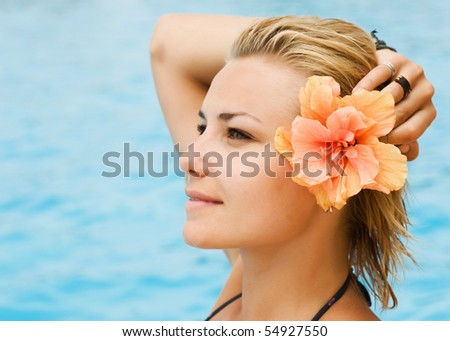Beautiful young woman at a pool.Vacation concept - stock photo