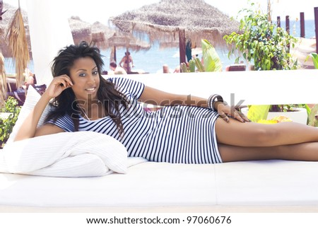Beautiful young woman at a tropical beach - stock photo