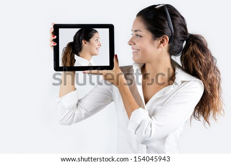 Beautiful young woman at home with digital tablet - stock photo