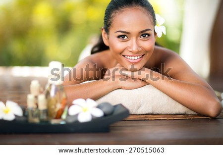 Beautiful young woman at spa outdoor  - stock photo