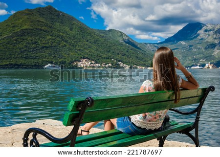 Beautiful young woman at the seacoast. Montenegro, Europe. - stock photo