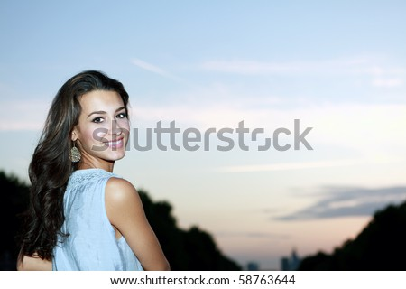 Beautiful young woman at the sunset hour in Paris, France. - stock photo