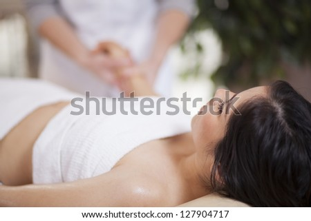 Beautiful young woman being pampered at a health and beauty spa - stock photo