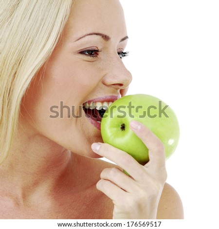 Beautiful  young woman bites a green apple, isolated on white - stock photo