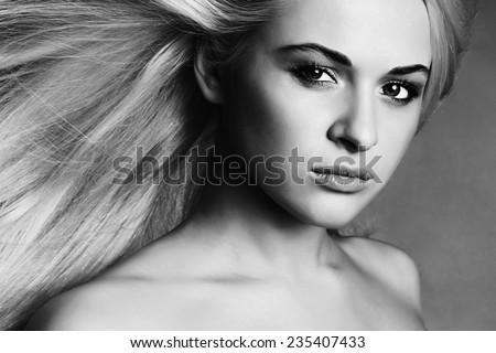 Beautiful Young Woman.Blond girl.close-up monochrome portrait - stock photo