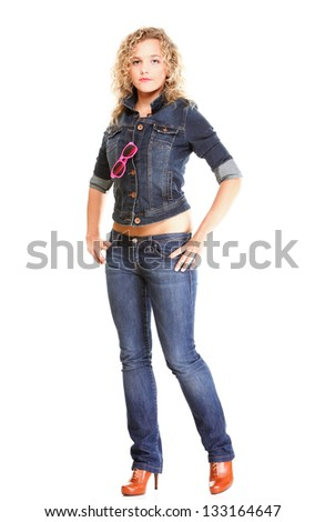 Beautiful young woman blonde 20s standing full body in jeans wear isolated on white background Caucasian girl - stock photo