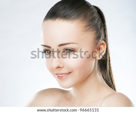 Beautiful Young Woman Brunette Face with a Wellness Complexion. Studio shot. Skincare Beauty concept - stock photo
