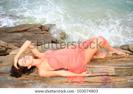 Beautiful young woman by the sea in Greece - stock photo
