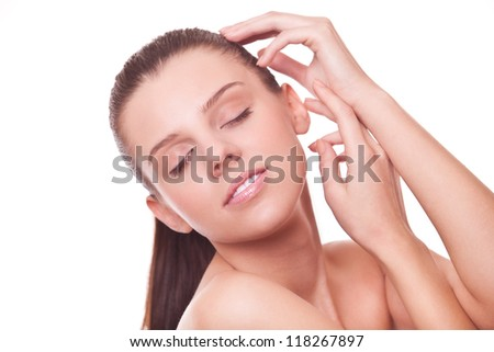 beautiful young woman cares for skin face, isolated on white background - stock photo