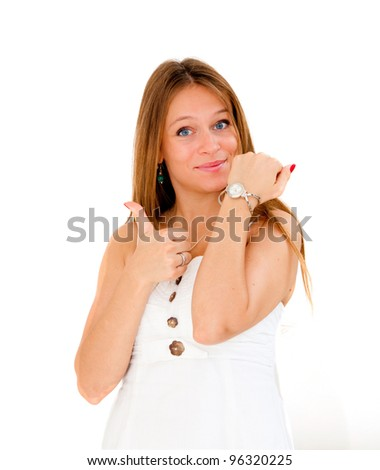 beautiful young woman checking the time on her wrist watch - stock photo